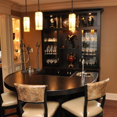 """Bar with Display Cabinets, built-in: stained Macassar ebony bar top with """"sunbur"""