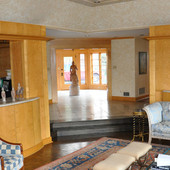 Paneled Room with Display Cabinets, built-in: travertine marble, stained birdsey