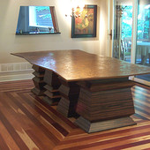 Dining table: glass, Macassar Ebony with clear natural finish.