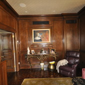 """Paneled Room, built-in: stained cherry, console: """"antiqued"""" gold leaf effect."""