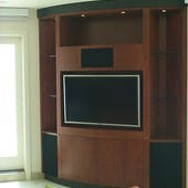 TV/Display Cabinet, built-in: natural kevazinga with black lacquered mahogany.
