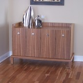 Console, freestanding: natural zebra wood with high gloss, hand rubbed finish.